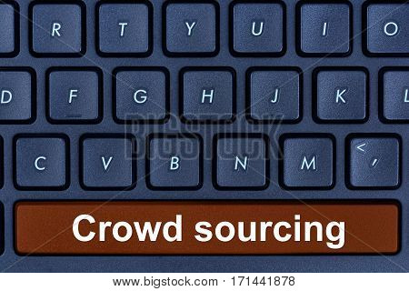 Crowd sourcing words on computer keyboard button closeup
