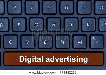 Digital advertising words on computer keyboard button closeup