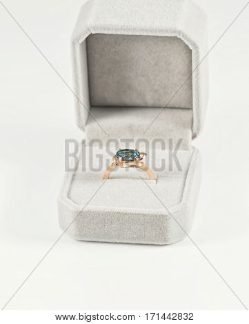 Gold Ring With Blue Topaz In A Velvet Gift Box