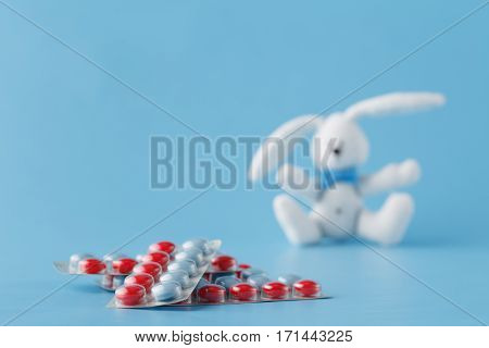 Pills In Blister On Blue Background