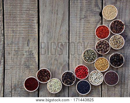 Spices On A Wooden Background. Coriander, Black Pepper, Paprika, Mustard, Turmeric, Cumin, Sumac, Fe