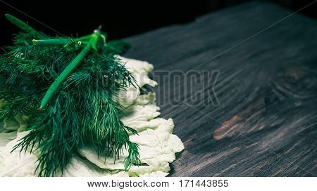 Fresh potherbs for cooking on black wood board
