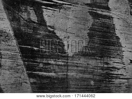The texture of painted iron with scratches. Horizontal background. Grunge. Black and white photo.