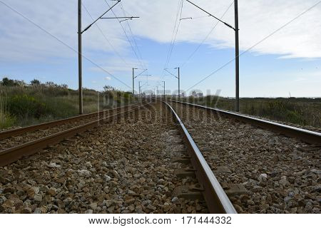 Daylight Railroad Tracks are Leading to Infinite