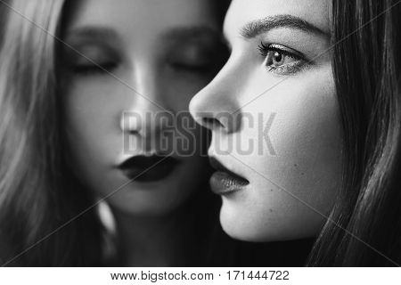 Black and white art photography monochrome two girls hug on the black background. Two lesbian women. Long hair. Beautiful sexy lingerie transparent. Love between girls.