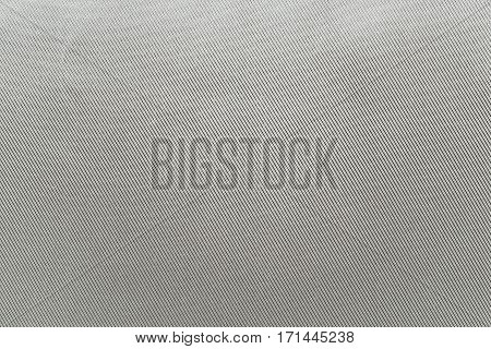 the textured background of fabric or textile material of pale silvery gray color