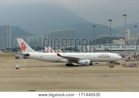 HONG KONG - NOV. 9, 2015: Dragonair Airbus 330-300 at the gate in Hong Kong International Airport (Chek Lap Kok Airport).