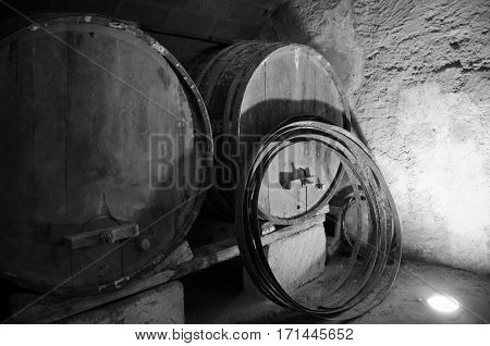 Wine production - huge old wine barrels in the cellar