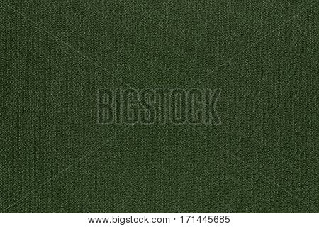 abstract texture and background of textile material or fabric of dark green color