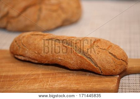 Long french bread on the cutting board.