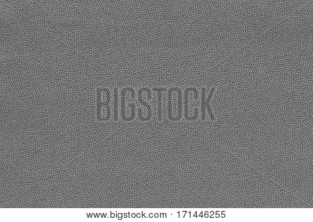 background and abstract grained texture of textile material or fabric of gray color