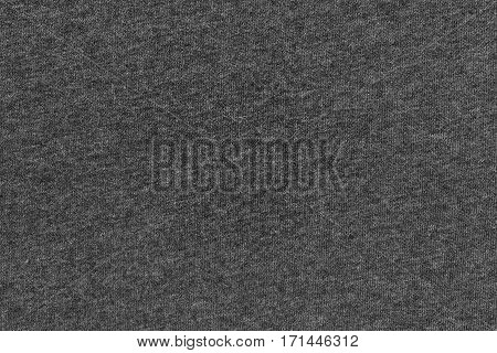 abstract background and texture of jersey or knitted textile fabric of black color