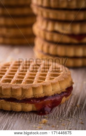 Several Biscuits With Homemade Marmalade On Light Board