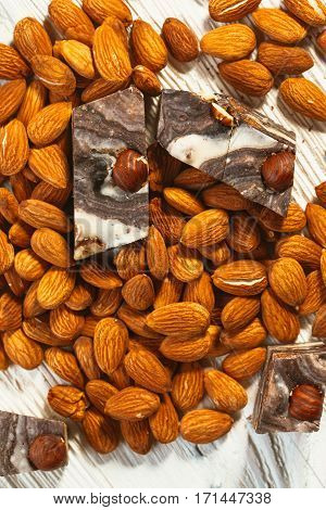 candy paste and almonds on white wooden background.