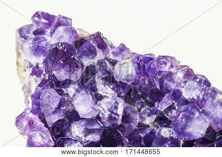 Purple to blue Amethyst crystal geode cut isolated on white background.