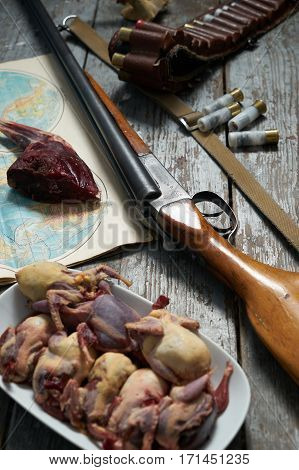 Hunting equipment on old wooden background. contept