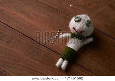 Cute Little Voodoo Doll with pins.Copy space.
