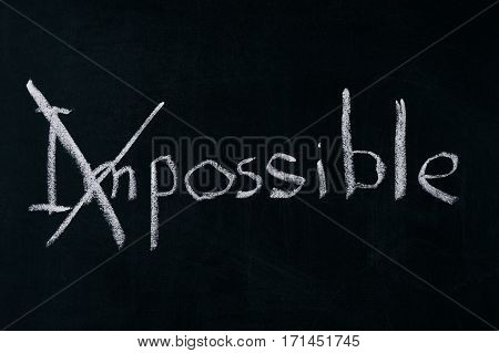 Changing the word impossible to possible on chalkboard.Motivation concept.