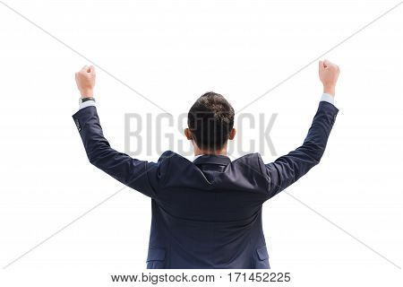 Celebrating success. Back view of excited young Asian businessman arms up while standing isolated on white background with clipping path.