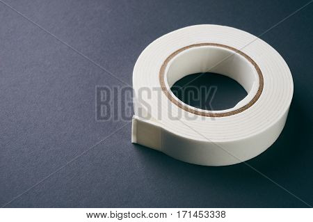 White double sided tape on gray background with copy space.Close up.