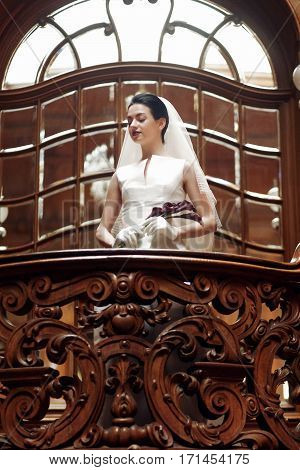 Elegant Gorgeous Bride Standing On Wooden Stairs Holding Calla Bouquet. Luxury Wedding Concept In Re