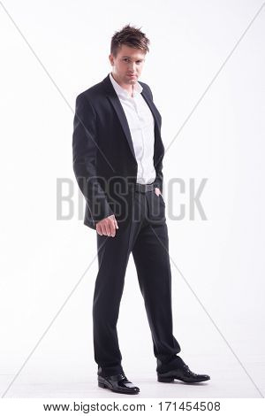 Full body shot of an young handsome man in a representative strict clothing smiling isolated on white background
