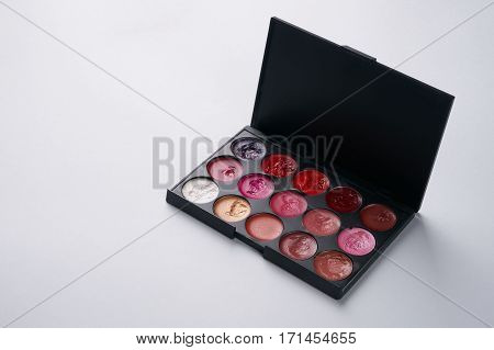 Make up professional cosmetics palette with eyeshadow isolated on white. Professional make-up tools closed-up with copy space.