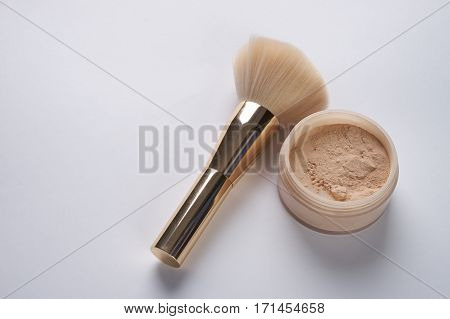 Face powder and brush isolated on white background.Copy space.
