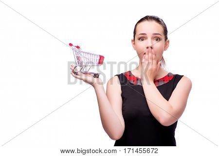 Young woman with shopping cart isolated on white
