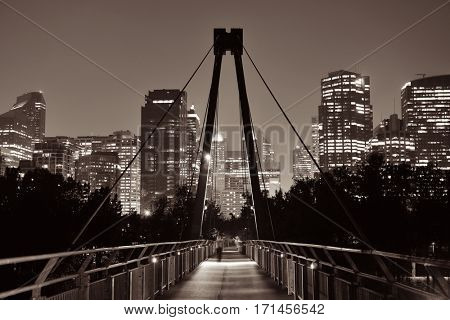 Pedestrian bridge and downtown skyscrapers at hight in Calgary, Canada.
