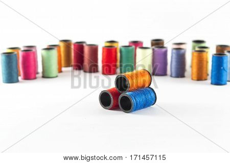 Colorful sewing threads on the white background