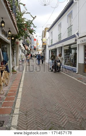 MARBELLA, SPAIN - DECEMBER 7, 2015: People in street decorated for Christmas in the city of Marbella Andalusia Spain