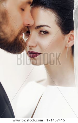Elegant Gorgeous Bride Gently And Stylish Groom Portraits, Posing In Light. Unusual Wedding Couple I