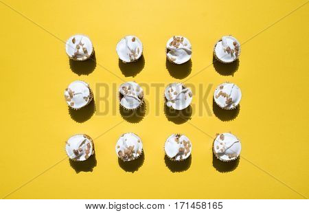 cupcakes on yellow background shot directly above