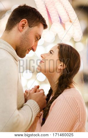 Romantic photo of young couple enamored at mall