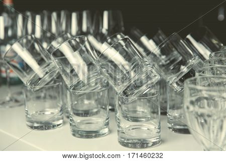 a lot of glasses of whiskey on the table. toned image