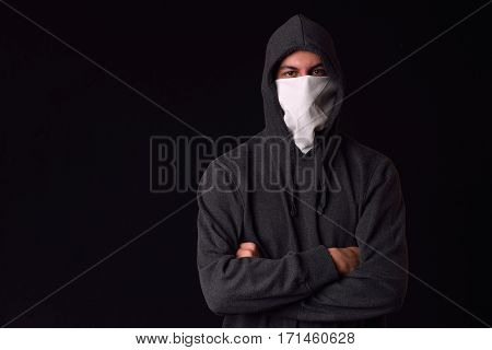 Unrecognizable Young Man Wearing White Balaclava And Black Hoodie Ready To Protest At A Rally On A D