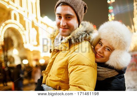 Happy lovers at winter walk in park
