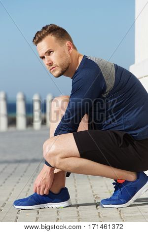 Active Sports Man Doing Shoelaces Up Before Workout