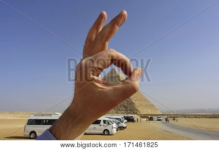 , tourists and the buses on the background. The world's oldest tourist attraction, the Pyramids of Giza are 5000 years old.