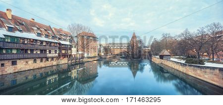 Winter landscape of fortification with a tower Fronveste Schlayerturm on Pegnitz river in Nuremberg, Bavaria, Germany