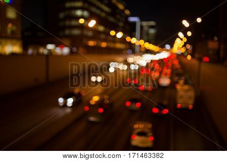 Night road with cars with headlights, photo defocused