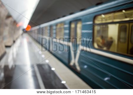 Blurred picture of metro with moving train inside tunnel