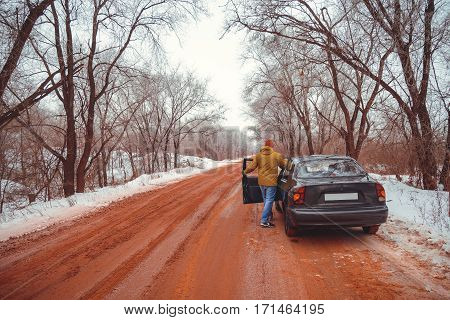 snowed road red because of or car at side of the road