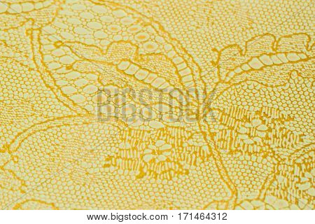 Genuine leather with an abstract ornament, tender color. Closeup on a leather texture. For modern pattern, wallpaper or banner design, place for your text