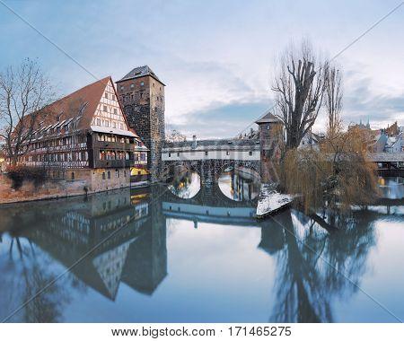 Winter panorama of Henker haus and Henkersteg bridge over Pegnitz river in Nuremberg, Bavaria, Germany