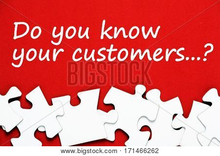 The question Do You Know Your Customers in white text on a red background above a pile of jigsaw puzzle pieces