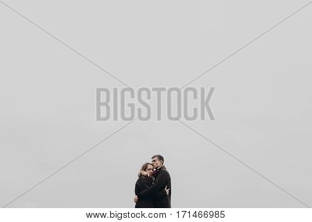 Stylish Hipster Couple Hugging Gently On Background Of Park. Sensual Atmospheric Moment With Space F