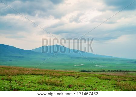 Scenic view in Tanzania with dramatic sky, depression near Ngorongoro crater
