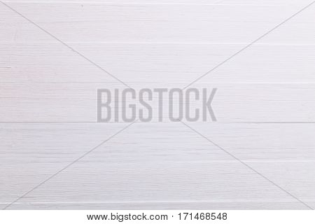 White wood background. Painted scraped wooden board. Bright texture or pattern.